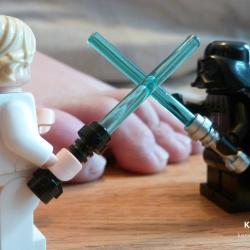 Foot fetish picture by foot model Karina. Her bare feet, toes, soles, playing with Lego Star Wars figures
