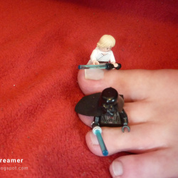 Foot model Karina showing her bare feet, toes, soles, with Lego Star Wars figures