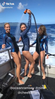Nina Dobrev with friends takes a shower on the boat 2018
