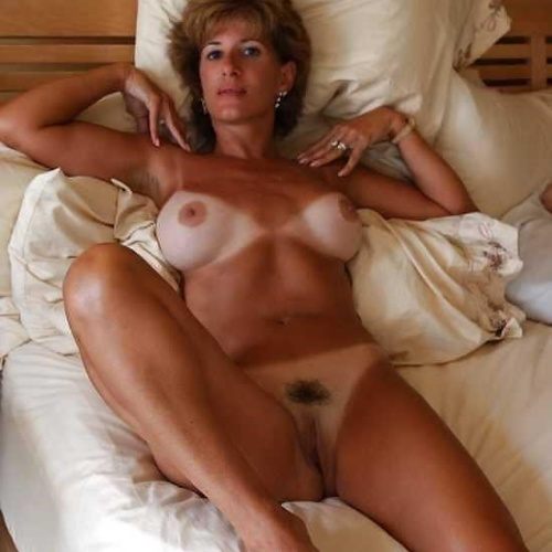 Naked mature women posing