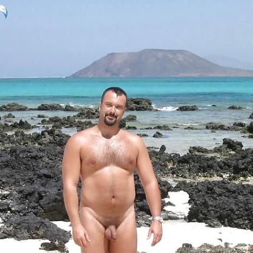 Naked black men at the beach