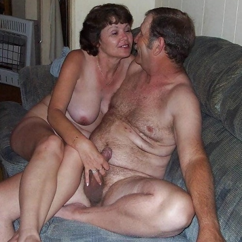 Mature couples copulating