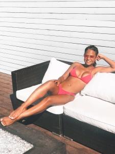 Christina Milian - Relaxes Wearing A Pink Bikini (3/30/18)