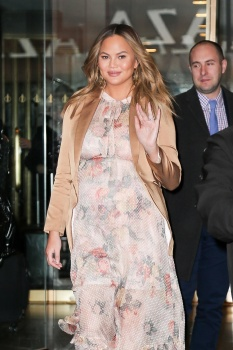Chrissy Teigen leaving the Today Show in 8