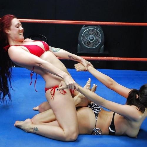 Nude women oil wrestling