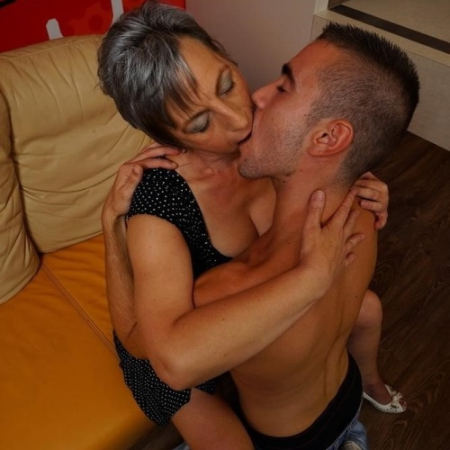 Naked women kissing boobs