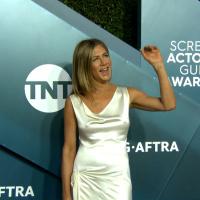 Jennifer Aniston wears white satin slip dress at SAG Awards 2020 (pokies)